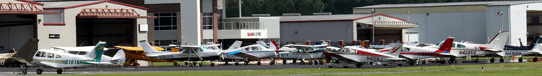 Aircraft Terminal and Hangars From Field | Raleigh Executive Jetport